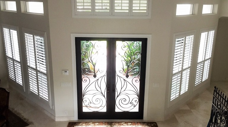 Tampa foyer with glass doors and plantation shutters