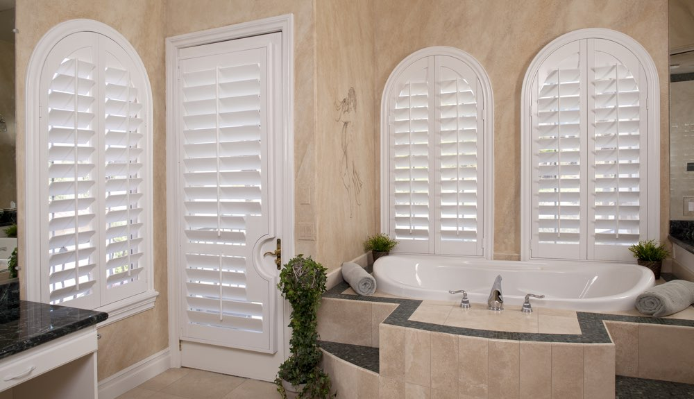 Arched Shutters In A Tampa Bathroom