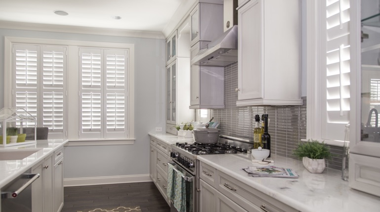 White shutters in Tampa kitchen with modern appliances.