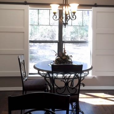 Tampa dining room barn door shutters.