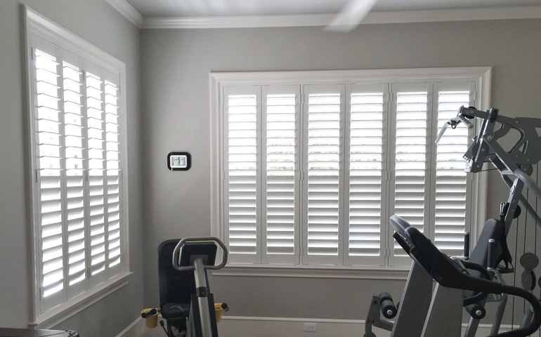 Tampa fitness room with shuttered windows.