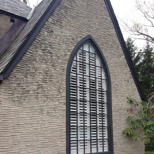 outdoor face of brick home with plantation shutters