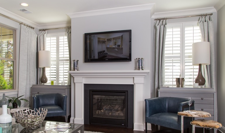 Tampa fireplace with white shutters.