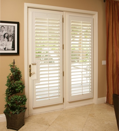 French back door with white plantation shutters