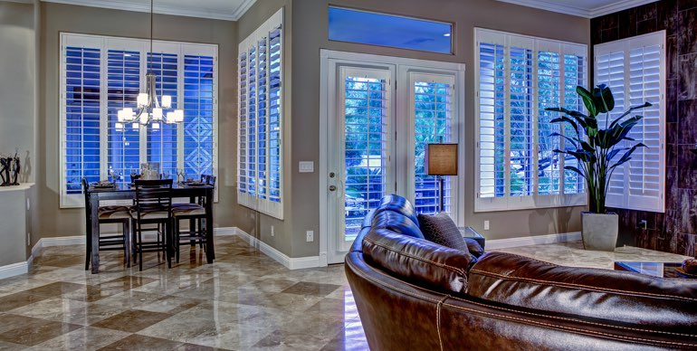 Tampa great room with classic shutters and leather furniture.