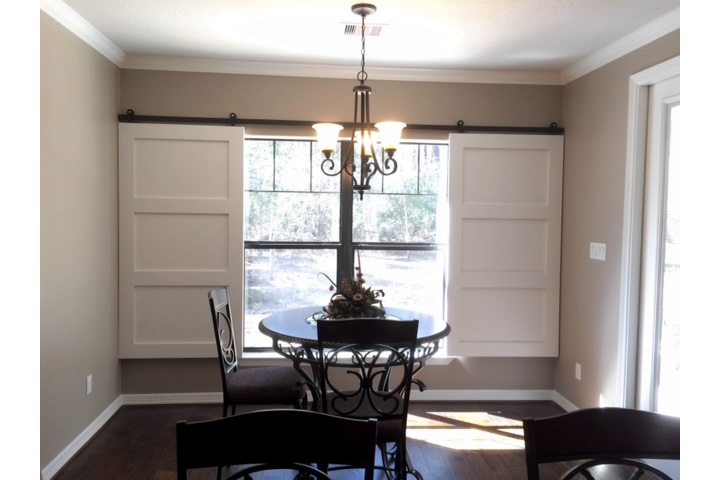 Tampa dining room with classic barn door shutters.