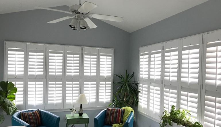 Tampa living room with fan and shutters