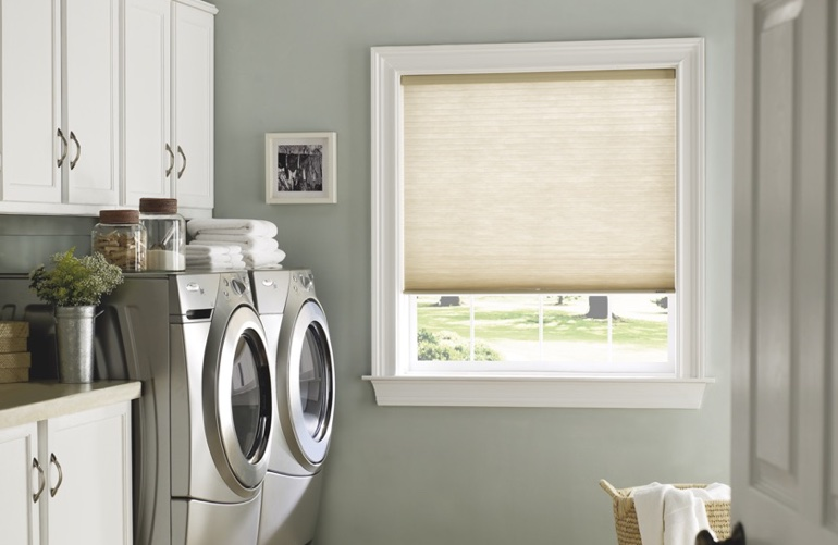 Tampa laundry room with tan window shades.