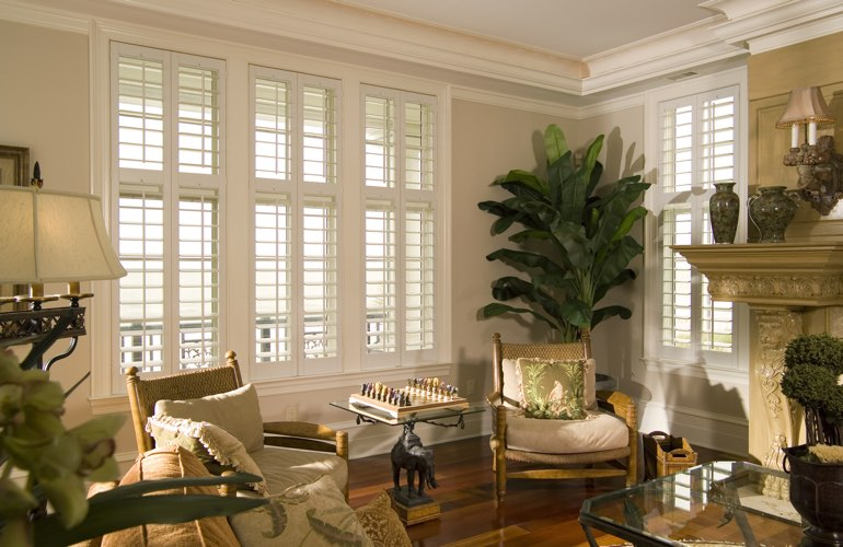 Living Room in Tampa with white plantation shutters.