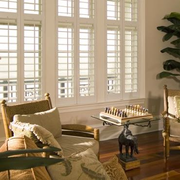Tampa living room plantation shutters.