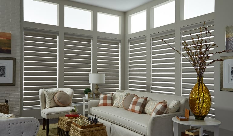 Motorized shades in a Tampa living room.