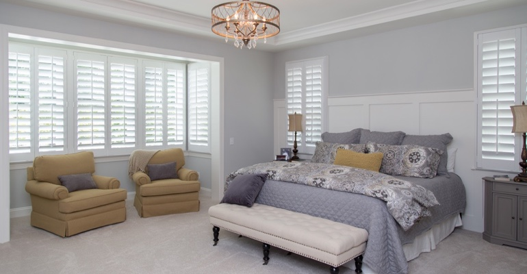 Plantation shutters in Tampa bedroom.
