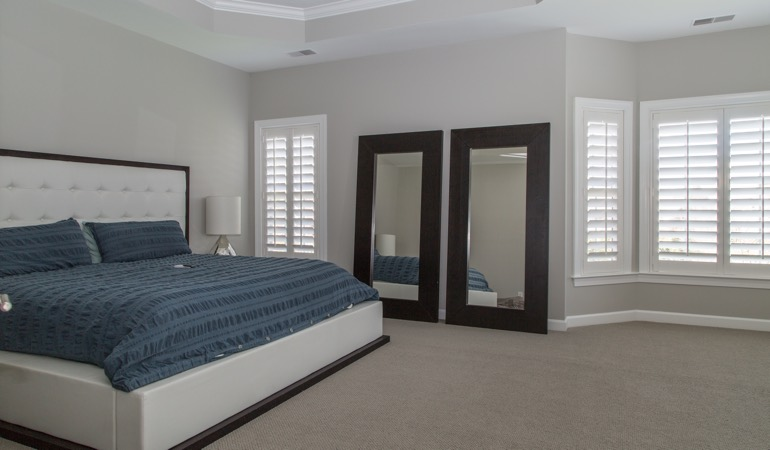 White shutters in a minimalist bedroom in Tampa.