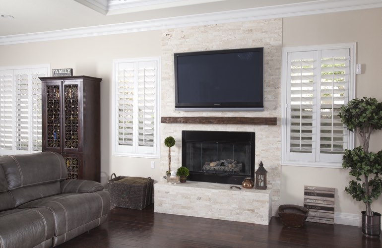 White plantation shutters in a Tampa living room with solid hardwood floors.