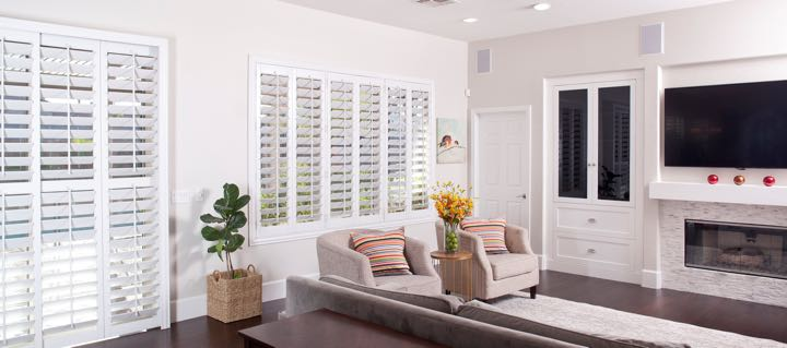 Tampa living room in white with plantation shutters.