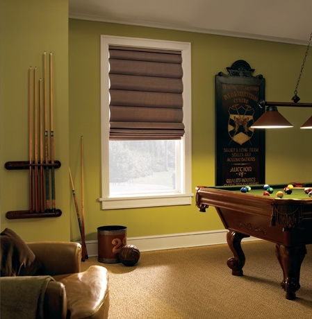 Roman shades in Tampa pool room with green walls.