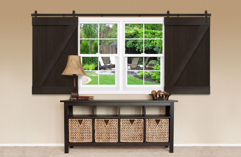 Dark sliding barn doors covering a window