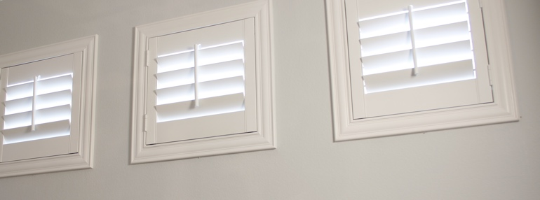 Square Windows in a Tampa Garage with Polywood Shutters