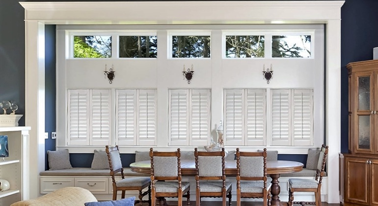 Tampa dining room with shut plantation shutters.