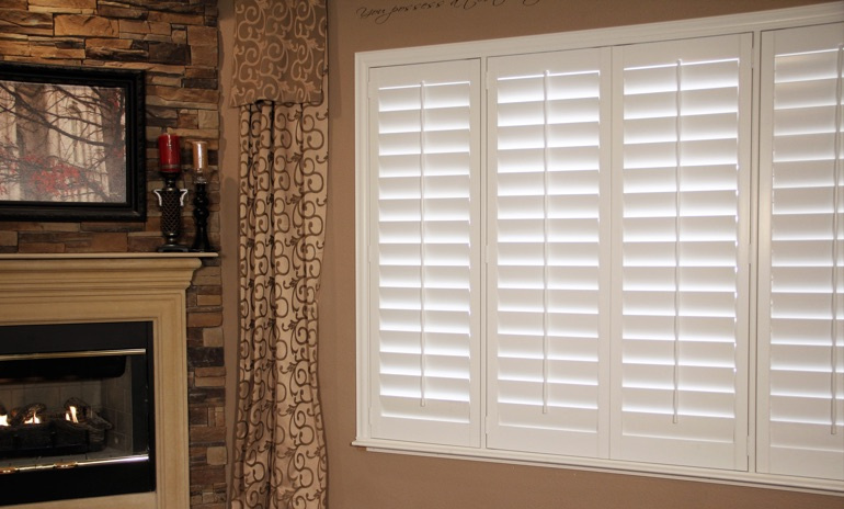 Tampa Studio plantation shutters in living room.