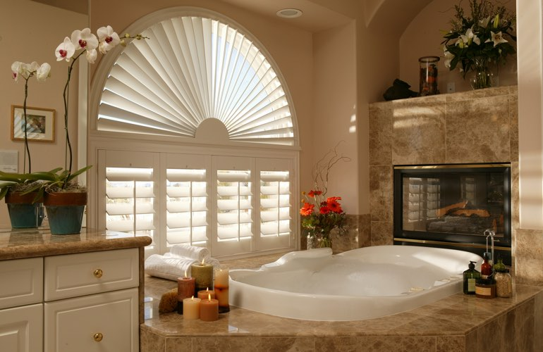 Arched shutters in a Tampa bathroom.