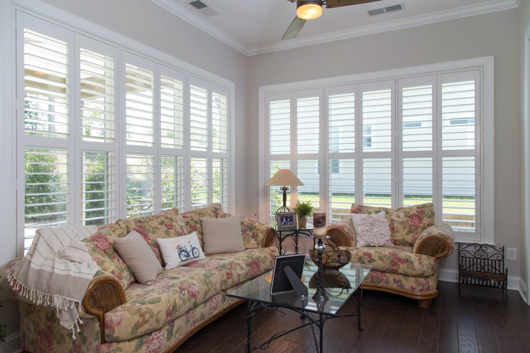 Traditional sunroom with interior shutters in Tampa.