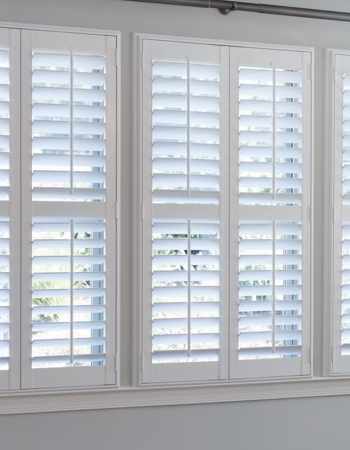 Hidden tilt rod shutters on Tampa windows