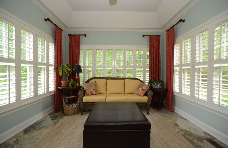 Sunroom with white plantation shutters