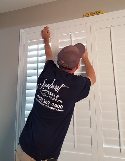 Shutter installation in Tampa bedroom.