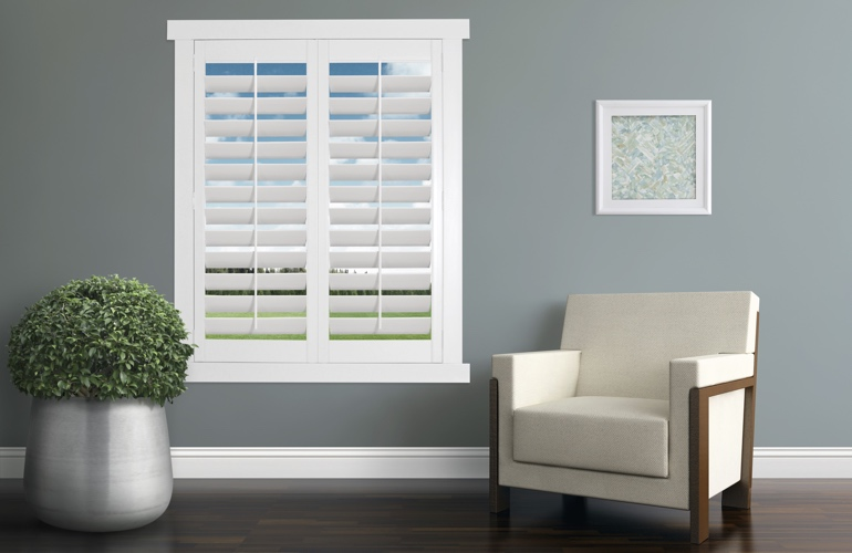 Contemporary room with white plantation shutters