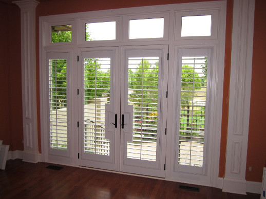 Tampa patio door with sidelight shutters