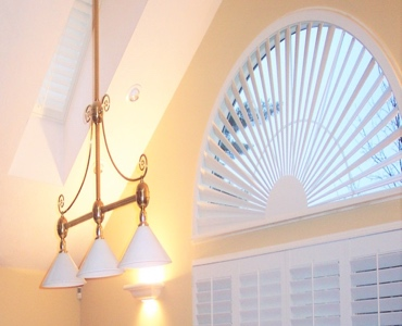 Tampa arched eyebrow window with plantation shutter