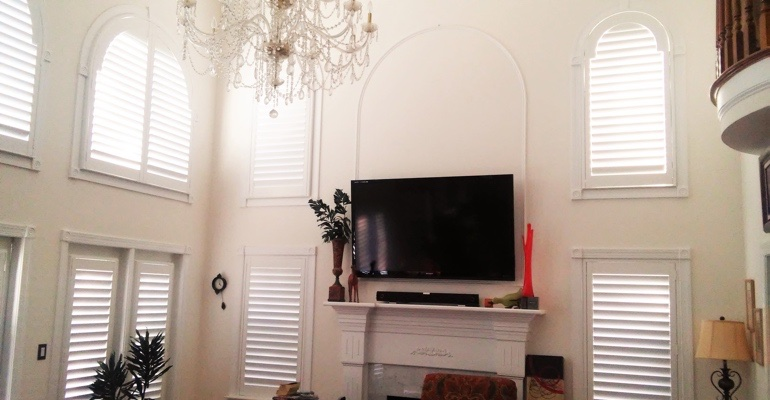 tall windows with shutters Tampa tv room