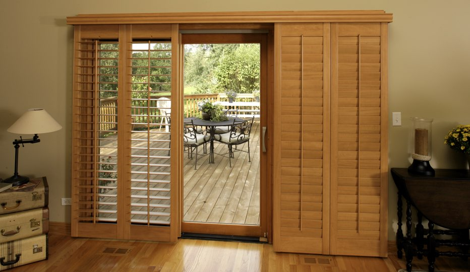 Good Bypass Wood Patio Door Shutters In A Tampa Living Room