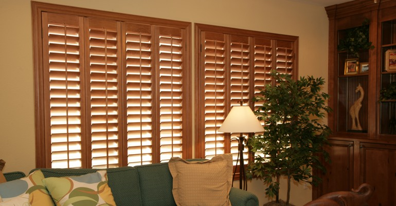 Wood shutters in Tampa living room.