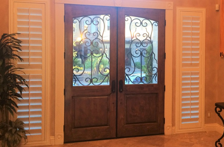 Sidelight window shutters in Tampa foyer