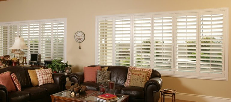 Wide window with interior shutters in Tampa living room