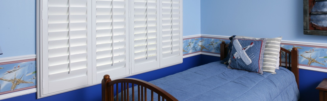 Blue boys bedroom with shutters